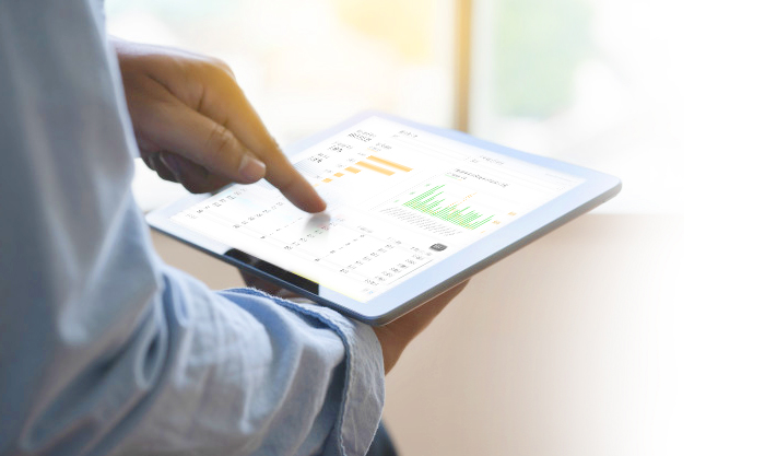 Man pointing at charts and graphs on a tablet